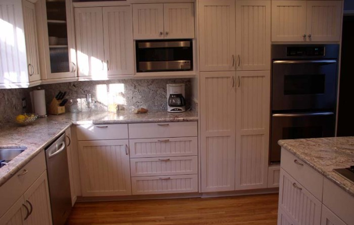 Frameless, Paint Grade With Beaded Door. Frameless, Arched Cabinets